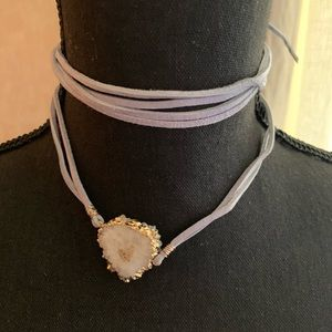 Cream colored druzy stone with gold raw edges